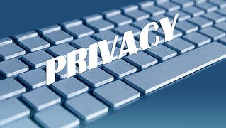 An image of a keyboard with the words PRIVACY written above it to signify our Privacy Policy
