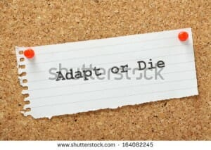 stock-photo-adapt-or-die-typed-on-a-piece-of-lined-paper-and-pinned-to-a-cork-notice-board-a-concept-for-164082245