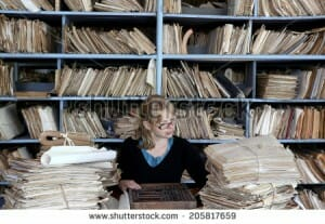 stock-photo-young-woman-working-in-an-oldfashioned-office-205817659