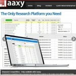 Ad for the Jaaxy keyword platform showing keywords results on an open laptop against a background filled with keywords.