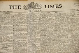 "The front page of the ""The Time"" newspaper loadeed with articles"