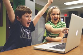 children excited before video on a laptop screen as How Wealthy Affiliate Has Helped Me in a Year with My Struggles to Succeed Online