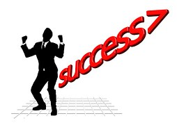 Image showing the silhouette of a dancing man and beside him red letters reading SUCCESS.
