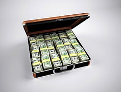 Wrapped dollar bills arranged in a brown briefcase.