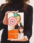 A person holding shopping images to signify shop at cbroads's clickbankl's digital storefront