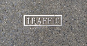 The word TRAFFIC written in the middle of a marbled floor.