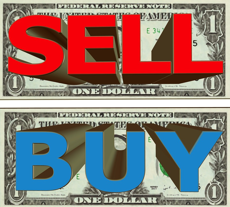 """Two one dollar bills the top showing a red sign """"sell"""" and the bottom """"buy"""""""