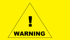 "Traingle drawn on a bright yellow background with the words ""Warning"""