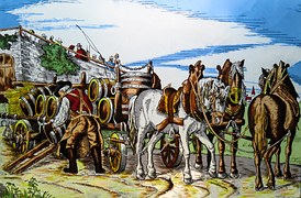 Horses ready to carry barrels of beer from a factory to supply outlets