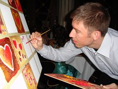 An artist working on a painting