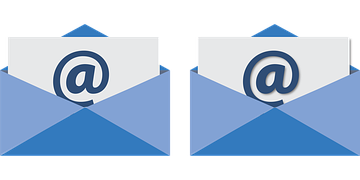 2 bluish enveloppes with greyish sheets bearing the sign @ being tucked into them