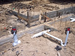 Foundation of a house showing the foundation blocks and the plumbing. designation 22 Steps to Having a Blog for Making Money Online