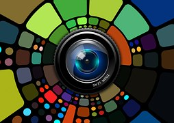 A zoom lens surrounded by artisitic colorful creations