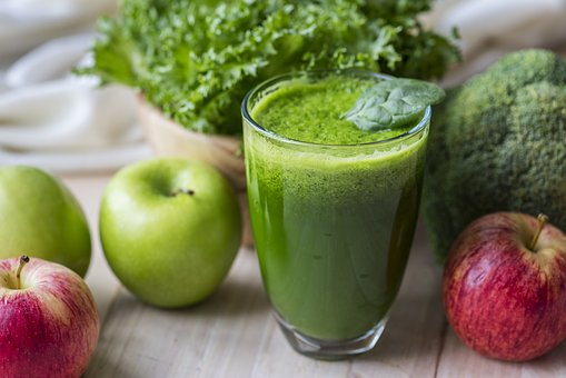 Green conction in a glass aq antioxidant to signify body detox