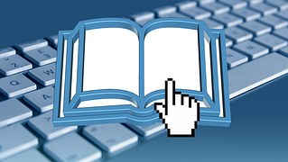 Drawing showing a finger pressing a book over a keyboard to signify ebook