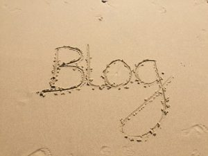 The word blog written in the sand
