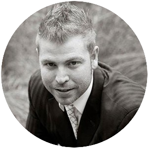 Black and white passport photo of Kyle Loudoun, Wealthy Affiliate co-founder and marketing chief to signify Who Are the Owners of Wealthy Affiliate?