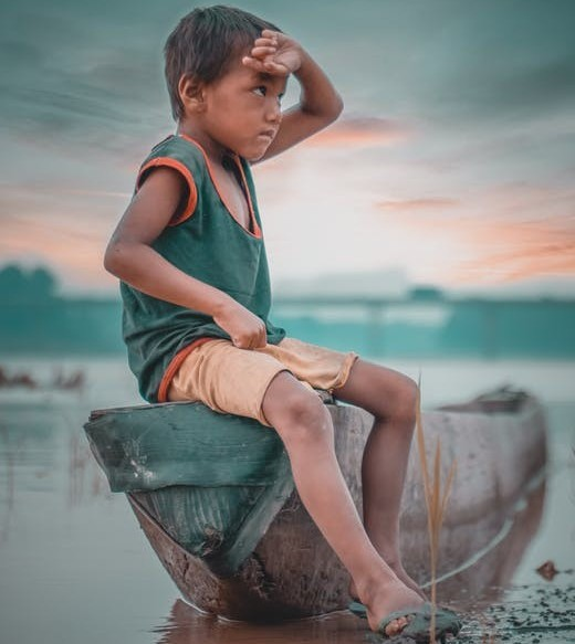 poor-boy-sitting-on-a-canoe-at-the-shore-for-7-poor-resons-to-enter-an-mlm