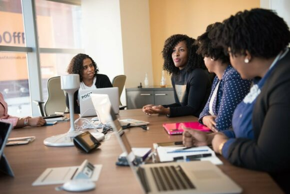 women-talking-around-a-table-to-signify-7-reasons-why-a-network-marketing-mlm-business-is-the-best-kind-to-own