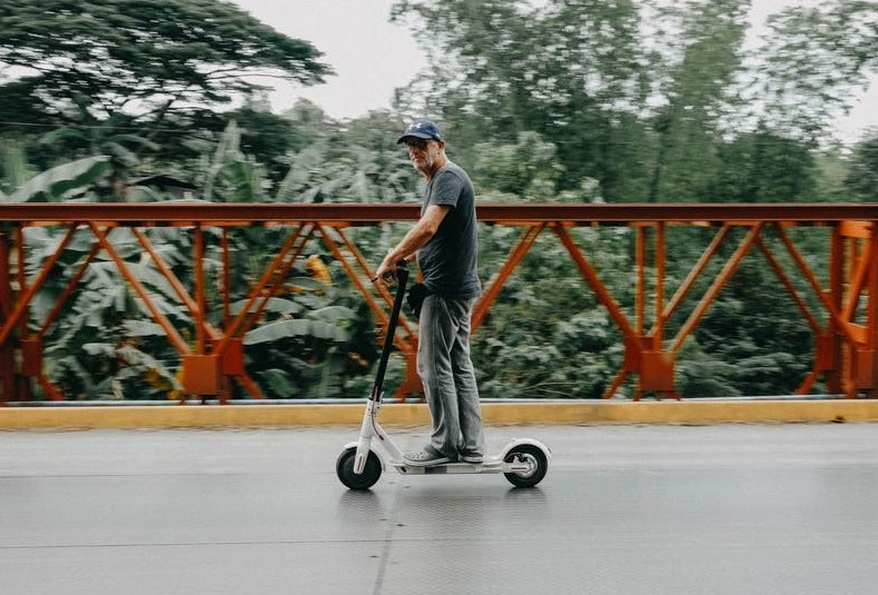 man-on-an-electric-scooter-for-before-you-buy-an-elctric-scooter-read-reviews
