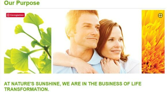 Man and woman smiling where nature's sunshine purpose is we are in the business of life transformation