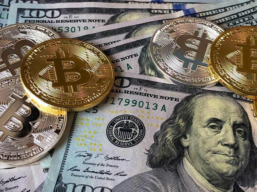 BitCoins and $100 dollar bills to signify Affiliate Marketing Combined With MLM