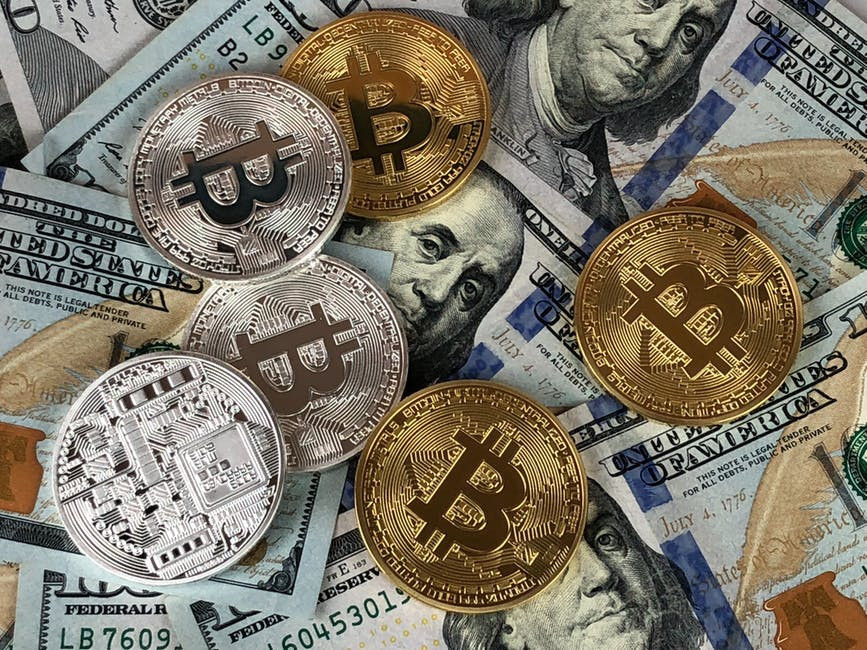 Dollar bills and bitcoins to signify How To Choose An Affiliate Program That Pays You Big Cash