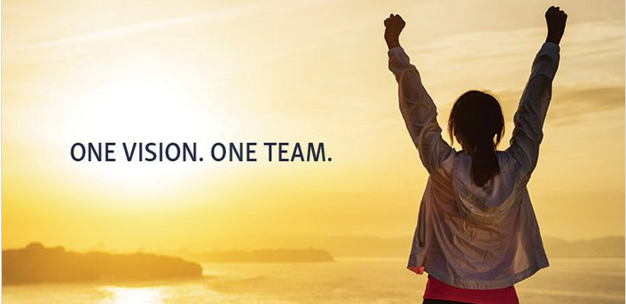 Lady with uplifted hands in a sunset with words 'One vision. One team' for Immunotec review