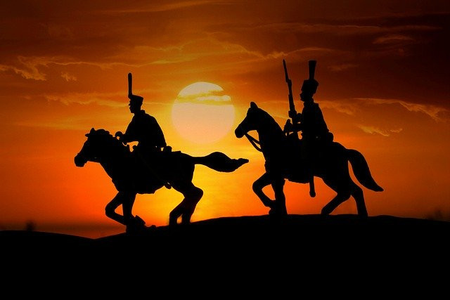 Two horse riders in full sunset to signify All About Opt-In MLM Leads - Best way to build your MLM business