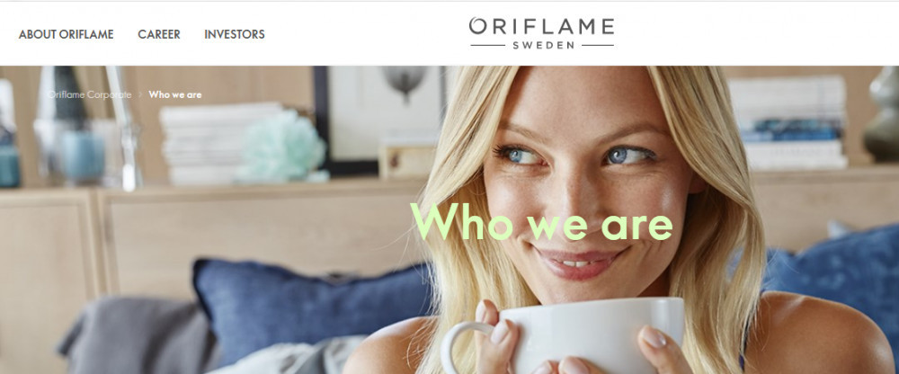 Smoling lady drinking coffee with words 'Who we are' to signify Oriflame Cosmetics Products versus Mary Kay