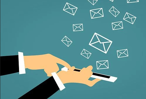 Email marketing with a finger touching a touch screen and emails flying out